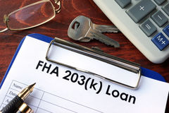 Clipboard with FHA 203k loan form. royalty free stock photos