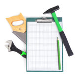 Clipboard and green tools Stock Image