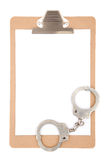Clipboard with handcuffs Royalty Free Stock Photography