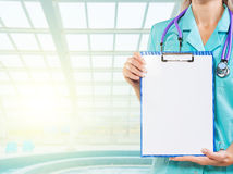 Clipboard in hands of female doctor Royalty Free Stock Images