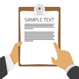 Clipboard in hands Royalty Free Stock Image