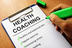 Clipboard with health coaching list. Healthy living concept royalty free stock image