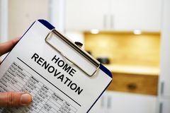 Home renovation cost or estimate. Clipboard with home renovation cost or estimate stock image