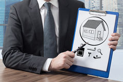 Clipboard with house Royalty Free Stock Image