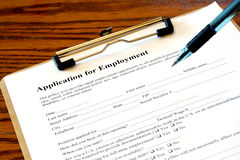 Clipboard with Job Application. Partial view of a clipboard holding an Application for Employment Stock Images