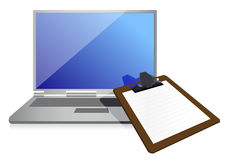 Clipboard and laptop Royalty Free Stock Image
