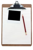 Clipboard, lined paper and photo. With white background stock photography