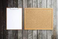 Clipboard and notice corkboard on old wood background. Blank Clipboard and notice corkboard on old wood background Stock Photo