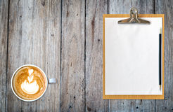 Clipboard with paper pencil and coffee on table Stock Images