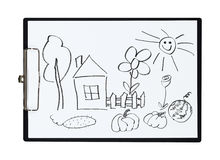 Clipboard and paper sheet with pencil drawing rural house and kitchen garden,  object Royalty Free Stock Photo