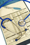 Clipboard With Patient Paperwork Stethoscope Pen Revised Royalty Free Stock Photos