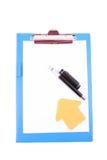 Clipboard with a pen Stock Photos