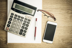 Clipboard with a pen and  calculator, eyeglasses Royalty Free Stock Photo