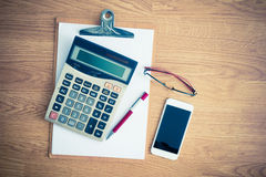 Clipboard with a pen and  calculator, eyeglasses Stock Images