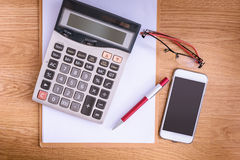 Clipboard with a pen and  calculator, eyeglasses Royalty Free Stock Photos