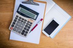 Clipboard with a pen and  notebook, calculator Stock Photos