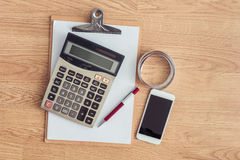 Clipboard with a pen and  notebook, calculator Royalty Free Stock Image
