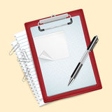 Clipboard with pen and paper clips Royalty Free Stock Images