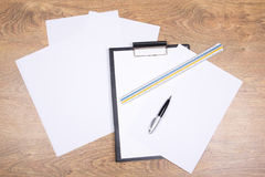 Clipboard, pen, straightedge and paper Royalty Free Stock Photography