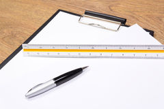 Clipboard, pen and straightedge on the table Royalty Free Stock Image