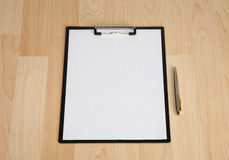 Clipboard and a pen on the table Royalty Free Stock Photography