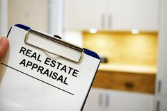 Clipboard with Real estate appraisal. Man holding clipboard with Real estate appraisal Stock Photography