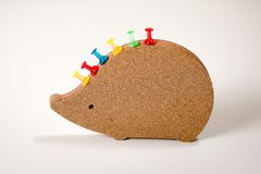 Clipboard in the shape of a hedgehog with colorful buttons royalty free stock photos