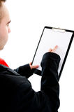 Clipboard with space for text. Young busiessman holding out a blank clipboard with space for text. Pointing on something with his finger Royalty Free Stock Image