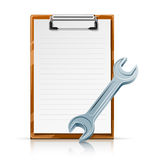 Clipboard with spanner Stock Photo