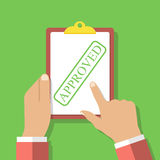 Clipboard stamped. Approved in the hands of men. Royalty Free Stock Image