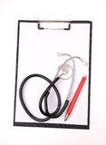 Clipboard, Stethoscope And Red Pen Royalty Free Stock Images