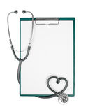 Clipboard and stethoscope in heart shape Stock Photography