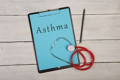 Clipboard with text & x22;Asthma& x22; and stethoscope on white wooden background. Medecine concept - clipboard with text & x22;Asthma& x22; and Stock Photos