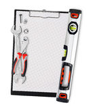 Clipboard with tools Stock Photography