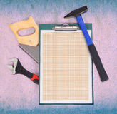 Clipboard and tools Royalty Free Stock Photography