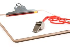 Clipboard and Whistle Stock Photo