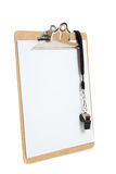 Clipboard with whistle on a white background Stock Image