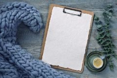 Clipboard with white paper. On a wooden background royalty free stock photo