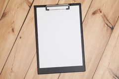 Clipboard with white sheet Stock Image