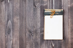 Clipboard on wooden background Royalty Free Stock Images