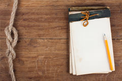 Clipboard on wooden background Stock Photos