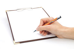 Clipboard with Writting Hand Stock Photography
