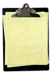Clipboard with Yellow Notepaper Stock Photography