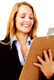 clipboardgranskningskvinna Fotografering för Bildbyråer