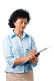 clipboardkvinnawriting Fotografering för Bildbyråer