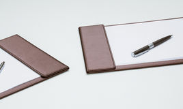 Clipboards with empty sheets of paper and  pens on the table Royalty Free Stock Image