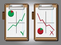 Clipboards with graphs. Two clipboards containing increasing and decreasing graphs Royalty Free Stock Image