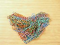 Clipes de papel coloridos, forma do coração do lugar Foto de Stock