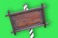 Clipped signboard. Empty wooden signboard of restaurant on a green background Royalty Free Stock Photo