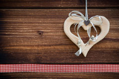 Clipped wooden heart hanging on sun burned wood. Planks with stitch Royalty Free Stock Images